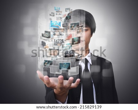 Businessman holding virtual button