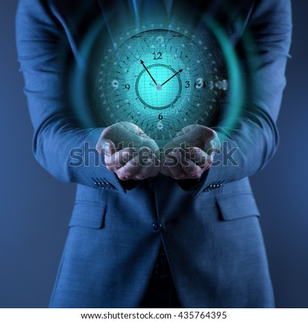 Businessman holding virtual clock in time is money concept - stock photo