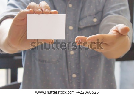 businessman holding white blank card with copyspace ready for your text or letters. - stock photo