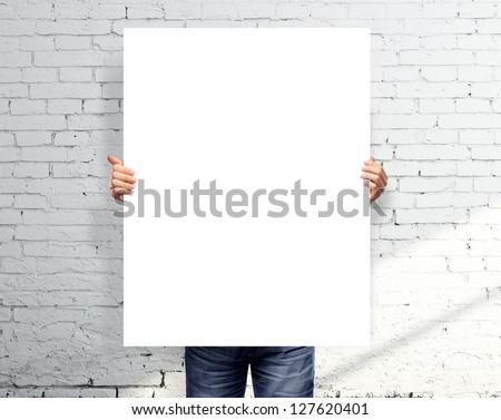 businessman holding white blank poster - stock photo