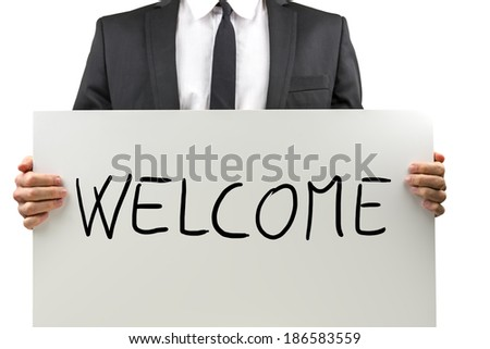 Businessman holding white board with Welcome sign on it.  - stock photo