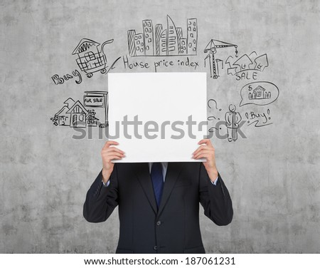 Businessman holding whiteboard and home sales wall sketch - stock photo