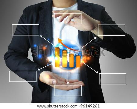 businessman holding world diagram - stock photo