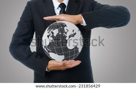 Businessman Holding World Map Globe for Business and Technology concept.