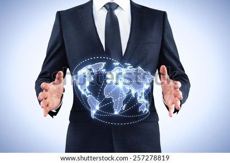 businessman holding world map interface on blue background - stock photo