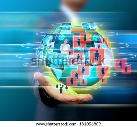 businessman holding world social network - stock photo