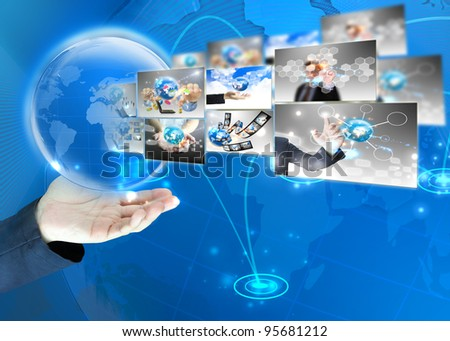 Businessman holding world .Technology concept - stock photo