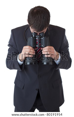 businessman holds binoculars down and looks at floor. Isolated on white background. - stock photo