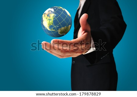 Businessman holds Earth globe in a hand present globalization. Elements of this image furnished by NASA  - stock photo
