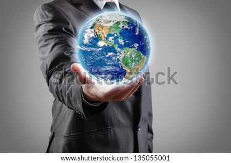 Businessman holds earth in a hand.Elements of this image furnished by NASA - stock photo