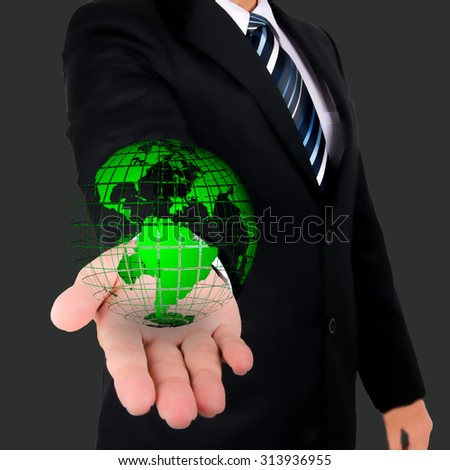 Businessman holds Earth in a hand , Elements of this image furnished by NASA
