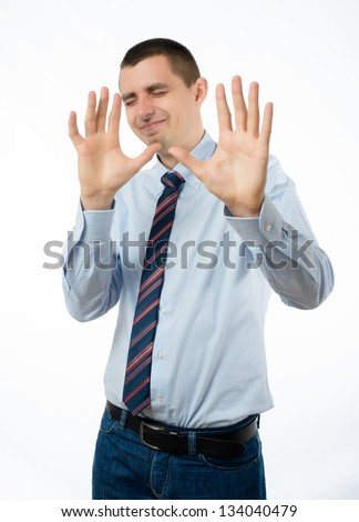 Businessman Holds Hand Out with Stern Expression - stock photo