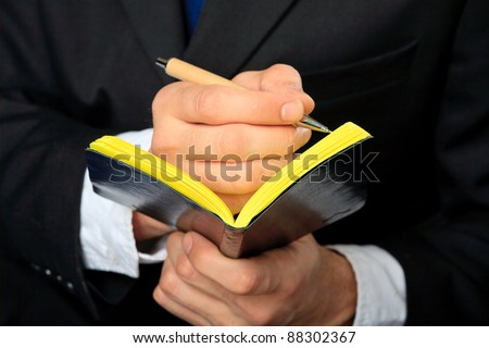 Businessman holds his notebook.  Close up. Concept. - stock photo