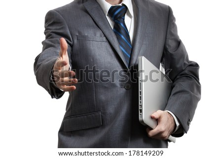 Businessman holds laptop and give hand - stock photo