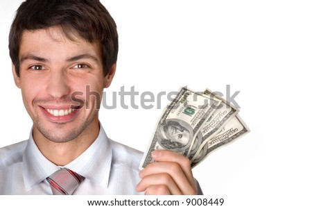 businessman holds money in a hand - stock photo