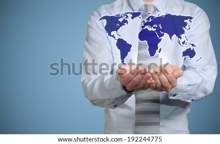 Businessman holds or holding world earth map in the palm of hands - stock photo