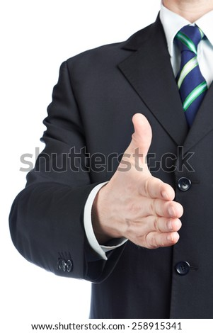 Businessman holds out his hand for handshake - stock photo
