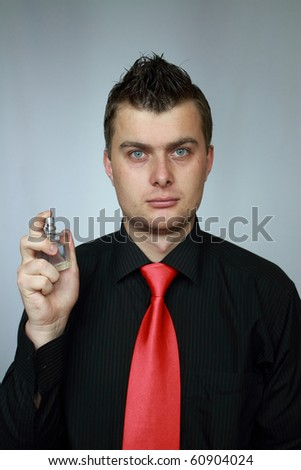 businessman holds spirits in the right hand - stock photo