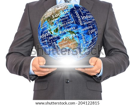 Businessman holds tablet pc with Earth in hand. On the globe written business words. Elements of this image are furnished by NASA - stock photo
