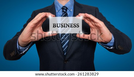Businessman holds white card with Business sign, Blue - Stock Photo - stock photo