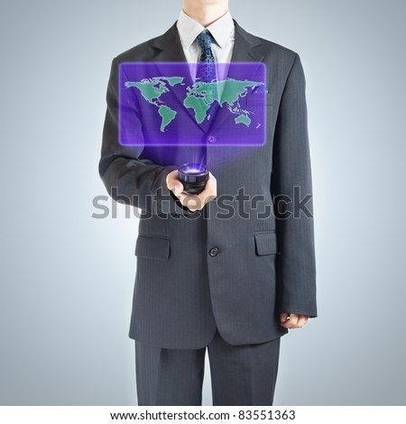 Businessman holographic projection of Earth map as a symbol of globalization. - stock photo