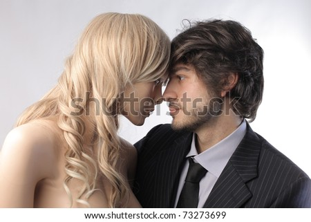 Businessman hugging a female mannequin - stock photo