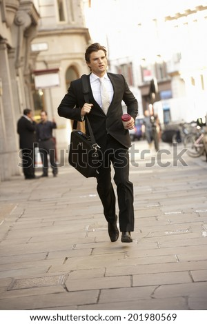 Businessman hurrying to work - stock photo
