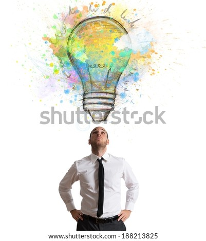 Businessman illuminated with a big creative idea - stock photo