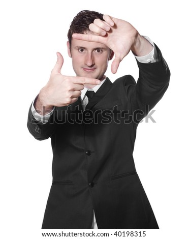 businessman in a black suit framing his face