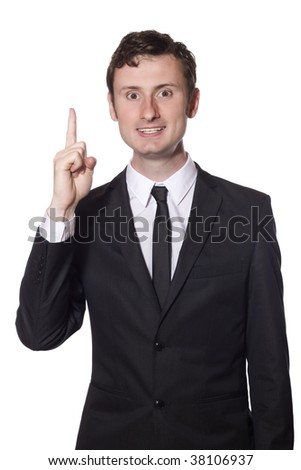 businessman in a black suit has an idea and a solution - stock photo