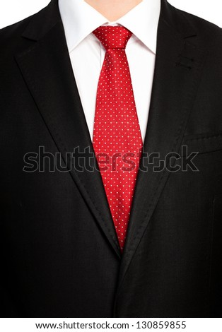 businessman in a black suit with a red tie - stock photo