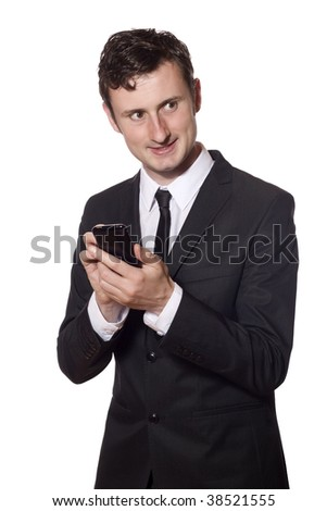 businessman in a black suit  with a smartphone - stock photo