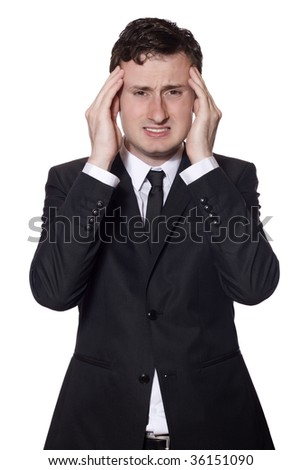businessman in a black suit with headache isolated on white - stock photo