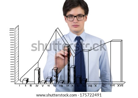 Businessman in a blue shirt drawing stock fluctuations in a glass screen - stock photo
