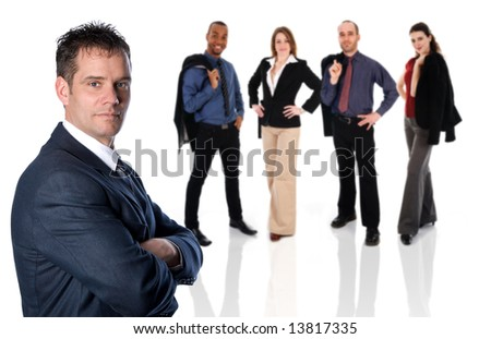 businessman in a blue suit with arms crossed - stock photo