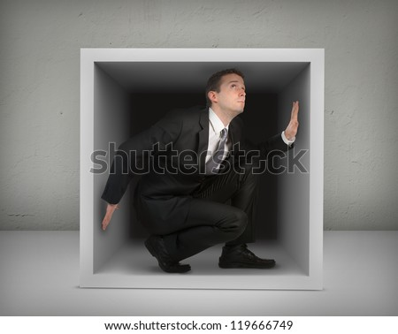 Businessman in a box