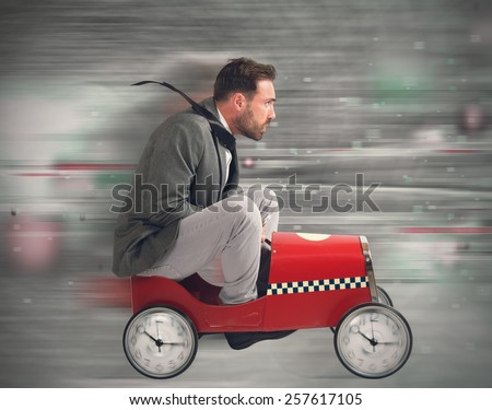 Businessman in a constant race against time - stock photo