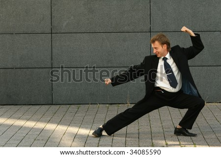 businessman in a fighting position - stock photo