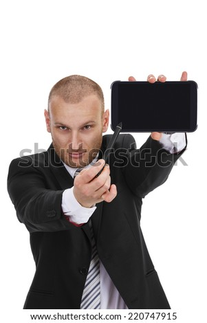 Businessman in a formal suit pointing with confidence to the empty screen of a tablet / phablet / phone, isolated on white - stock photo
