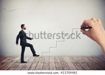 Businessman in a formal wear climbing drawn stairs, side view - stock photo