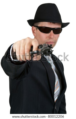 businessman in a hat and sunglasses with a gun on a white background - stock photo