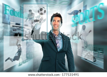 Businessman in a high-tech background with sports images - stock photo