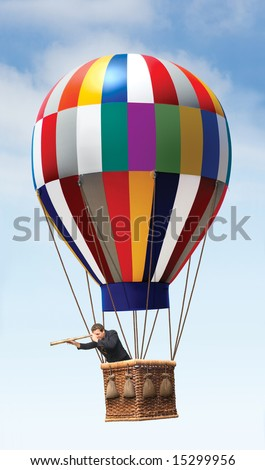 Businessman in a hot air balloon looking with a teleescope - stock photo
