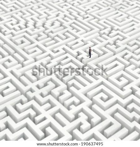 Businessman in a maze - stock photo