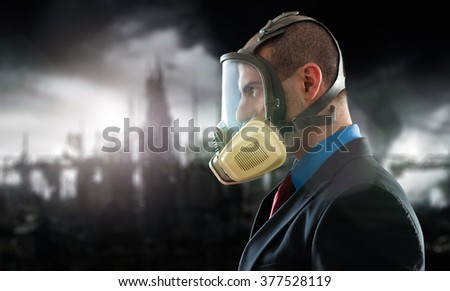 Businessman in a ruined world - stock photo