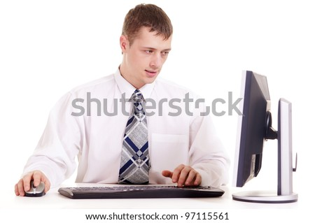 businessman in a shirt sitting at a laptop on a background