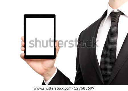 businessman in a suit and tie, holding a tablet computer with isolated screen - stock photo