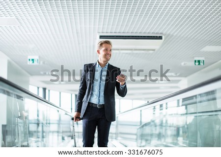 Businessman in a suit at the airport - stock photo