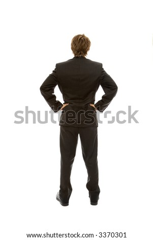Businessman in a suit faces away with confidence - stock photo