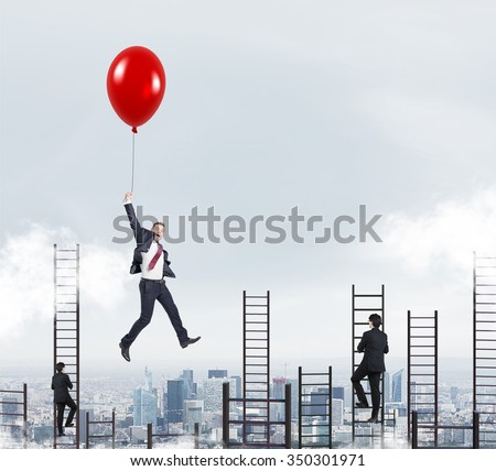 businessman in a suit flying happily holding a balloon over Paris, men climbing ladders, concept of success and career growth - stock photo
